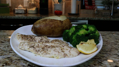 Baked Walleye with garlic baked potato and steamed broccoli