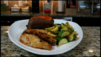Pan fried Coconut Crusted Perch with baked sweet potato and sauteed squash and zucchini